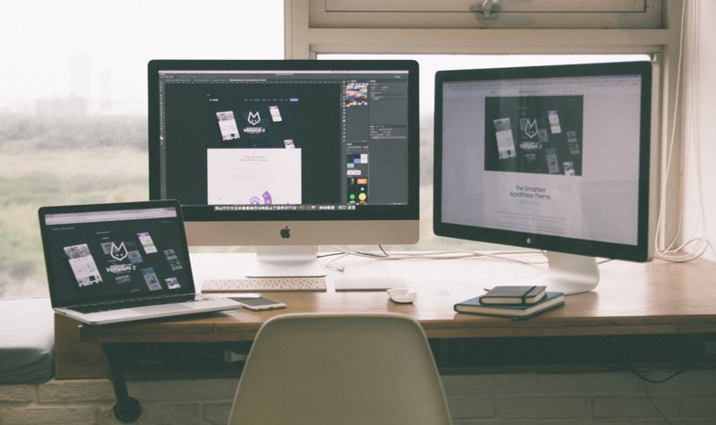 How To Choose A WordPress Theme Header Image Of Two Mac Desktop Pcs And Laptop On Desk