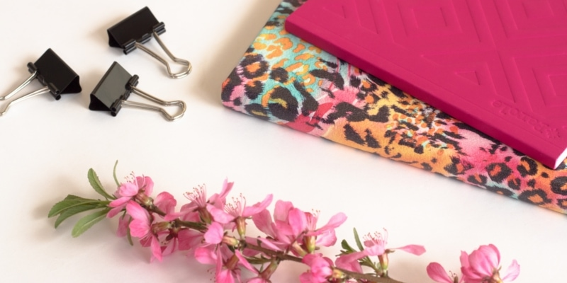 Pink And Leopard Patterned Notebooks With Pink Flower And Black Paper Clips