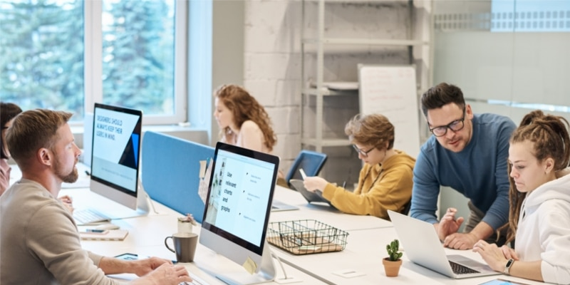 Bright Blogging Office With Entrepreneurs Working From Computers And Laptops